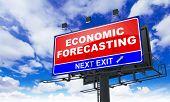 Economic Forecasting Inscription on Red Billboard.