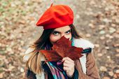 stock photo of beret  - Beautiful young women with a red beret - JPG