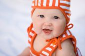 Adorable baby girl smiling outdoors