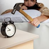 Asian Girl  Hit Alarm Clock With Hammer