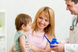 stock photo of douche  - doctor counseling mother and boy about nasal irrigation or douche with neti pot - JPG