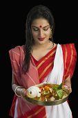 pic of pooja  - Beautiful woman in a Bengali sari holding pooja thali - JPG