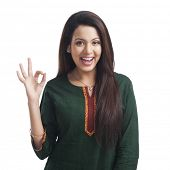 foto of salwar  - Portrait of a woman showing ok sign and smiling - JPG