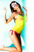 image of wet t-shirt  - young brunette in bikini and wet t shirt summer day - JPG