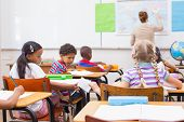 stock photo of misbehaving  - Naughty pupil in class at the elementary school - JPG