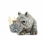 picture of stone sculpture  - Rhinoceros rhino sculpture made of colored stone isolated over white background - JPG
