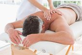 picture of health center  - Man receiving back massage in spa centre - JPG