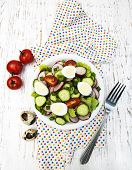 picture of radish  - Spring salad with eggs tomato cucumbers and radish on a wooden background - JPG