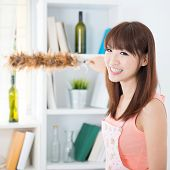 picture of apron  - Happy Asian housewife with apron cleaning house - JPG