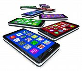 stock photo of mobile-phone  - Many smart phones with application tiles on their touchscreens - JPG