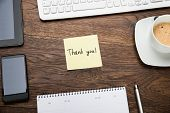 image of thank you note  - High Angle View Of Text Thank You On Post Note At Wooden Desk - JPG