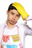 Expressions. Tired Man In Apron And Yellow Glove For Washing Dishes