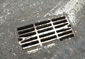 image of cross-hatch  - Drain grate on the road with old white road marking line  - JPG