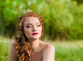 stock photo of freckle face  - Portrait of a beautiful red - JPG