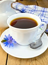picture of milkman  - Chicory drink in a white cup with a flower on a saucer and spoon - JPG