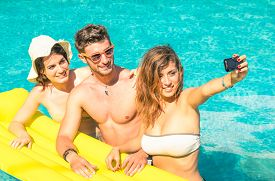 pic of  friends forever  - Group of best friends taking selfie at the swimming pool with yellow airbed  - JPG