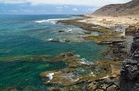 stock photo of naturist  - Gran Canaria El Confital beach on the edge of Las Palmas La Isleta peninsula - JPG