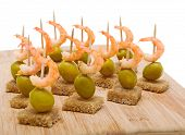 Canapes Of Black Bread, Shrimp And Olives