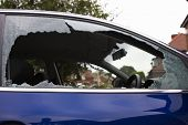 stock photo of car-window  - smashed safety glass in a car door - JPG