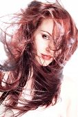 stock photo of red hair  - Red haired model in studio with hair blown around - JPG