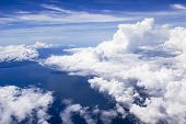 Sky, Clouds, Earth And Ocean
