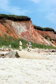 image of martha  - Clay cluffs and stacked stones on the sandy beach of Gayhead/Acquinnah on the island of Martha