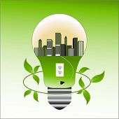 Concepto de medio ambiente - ciudad en la bombilla con el zócalo y enchufe deja alrededor de