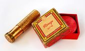 Brass lipstick container and rouge on