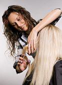 hairdresser in work. studio shot over grey background