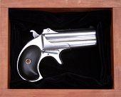 Circa 1889, Model 95, Type II Model 3 Double Derringer in its hand made wooden box on black velvet