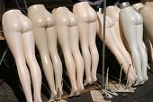 mannequins lined up at a swap meet