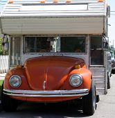 a probably one of a kind volkswagon beetle camper.........way cool