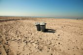 trash cans on the beach in southern california