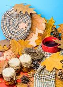Hat Scarf And Honey Natural Sweets In Jars Near Mug Of Tea Background Covered Fallen Leaves. Autumna poster
