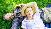 Nature Fills Them With Tranquility And Peace. Man Unshaven And Girl Lay On Grass Meadow. Guy And Gir poster