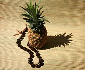 pic of kukui nut  - a fresh pineapple with a  - JPG
