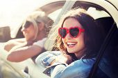 summer holidays, valentines day, travel, road trip and people concept - happy teenage girls or young poster