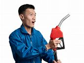 Oil Engineer Man Holding Fuel Oil Nozzle For Oil System Gasohol 91. poster