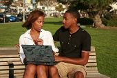 a young african american girl is upset at her boyfriend with what she finds while using a laptop com