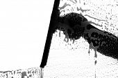 foto of window washing  - black and white silhouette of a window washer washing a window - JPG