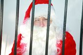stock photo of 24th  - santa claus is behind bars in jail and needs your help to either be bailed out or escape before december 24th or there will no No Christmas for anyone this year - JPG