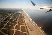 Leaving Los Angeles airport in an airplane aka LAX and flying over the pacific ocean on the way to Maui Hawaii