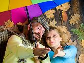Romantic Couple Dating. Hipster With Beard And Cheerful Girl Expect Rainy Weather Hold Colorful Umbr poster