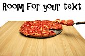 foto of pizza parlor  - hot fresh pepperoni pizza with a slice being served to a hungry customer - JPG