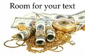 "picture of gold  - ""Cash for gold"" or ""Cash 4 Gold"" a leather pouch filled with gold jewelry lays upon a pile of cash isolated on white with room for your text. represents CASH FOR GOLD business concepts - JPG"