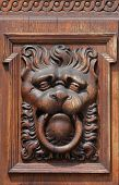 Medieval wooden sculpture of a fabulous monster on the gate of the Old Town Hall in Prague, Czech Re