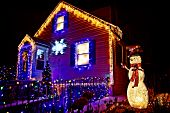House Decorated For Christmas. Beautiful Christmas Decorations Outside The House At Night. Selective poster