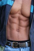 Muscular male torso in an undone jacket