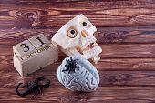 Halloween. Plastic Human Skull, Brain, Scorpio And Spider Laying On Wooden Background Near Blocks Ca poster