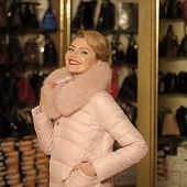 Sensual Woman In Winter Coat, Luxury, Moneybags, Business. Sensual Woman Buy Fur Coat In Shop, Winte poster
